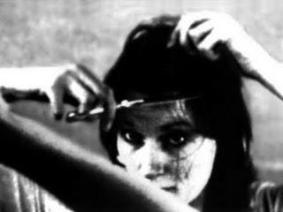Amanda Feilding, cutting her hair in preparation for her self-trepanation.